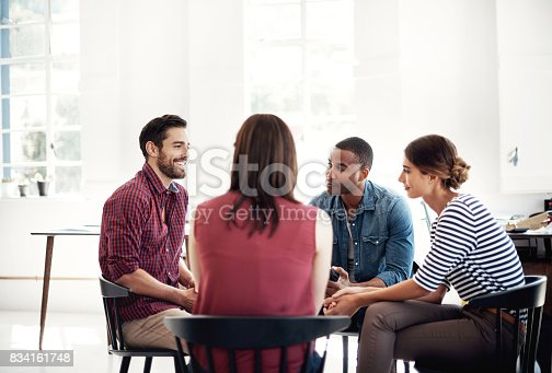 Shot of a group of colleagues having a discussion in a modern office