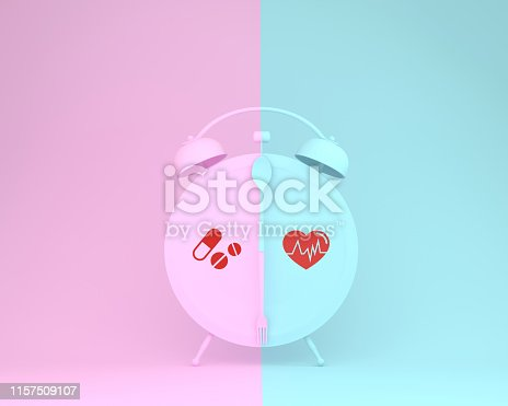 917079152istockphoto Creative of spoon and fork on round plate in a form of alarm clock with icon healthcare medical on pink and blue pastel background. Minimal concept of Insurance for your health. 1157509107