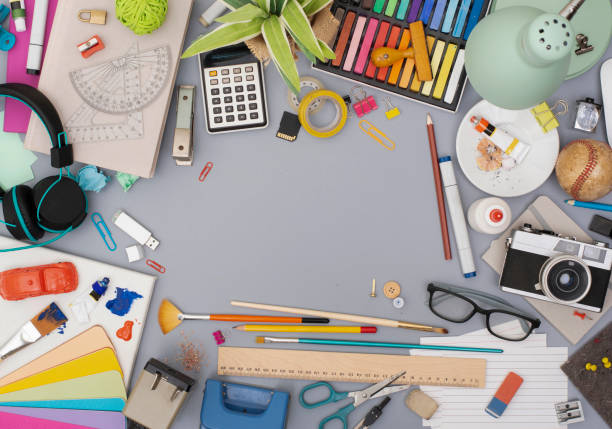 Creative office desk background Top view retro  messy office desk with hobby items and copy space in the middle. Hero header background. messy home office stock pictures, royalty-free photos & images