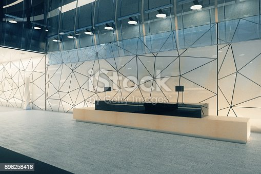 istock Creative office interior with reception 898258416