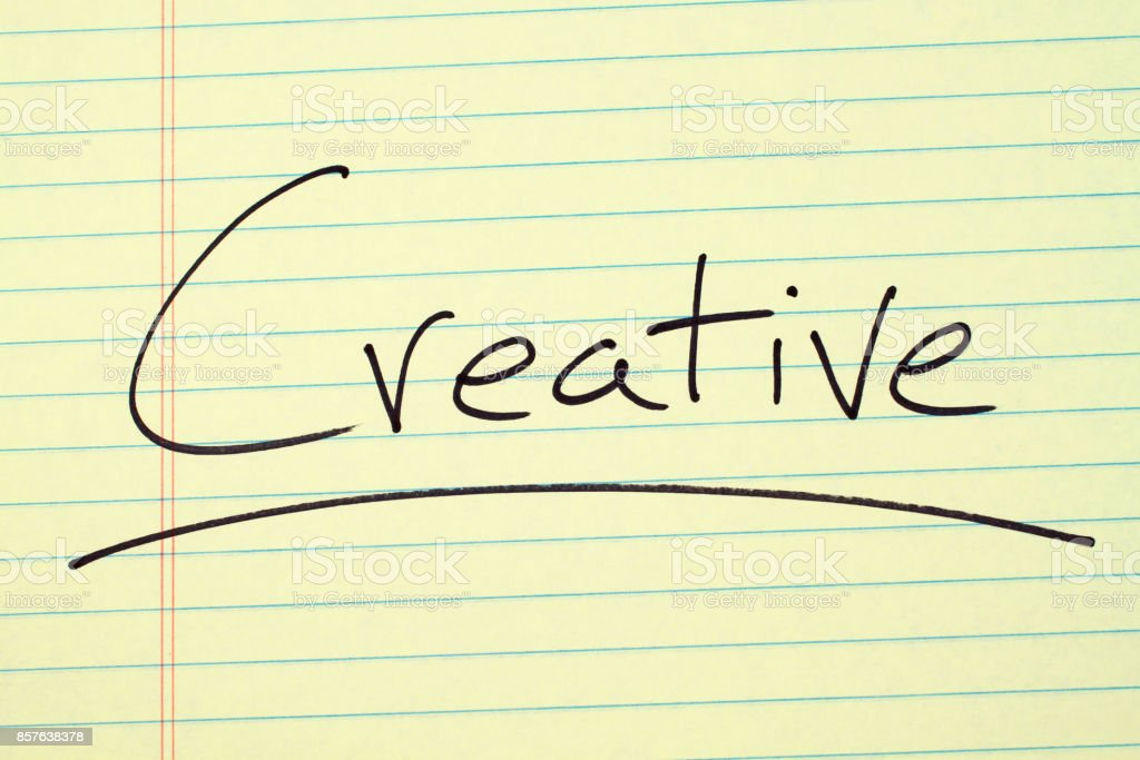 Creative On A Yellow Legal Pad stock photo