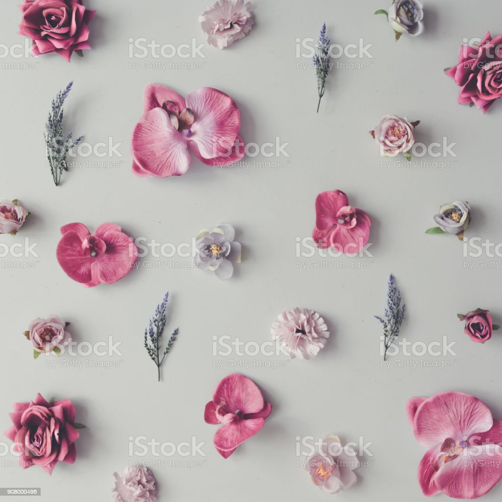 Creative pattern made of violet and pink flowers. Flat lay. Minimal...