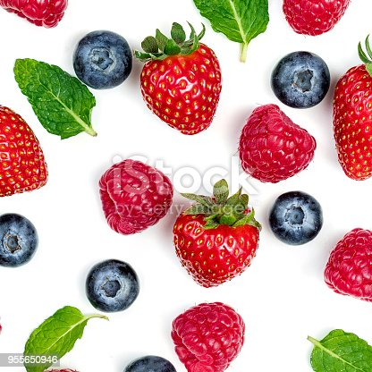 942159066 istock photo Creative pattern with various fresh berries isolated on white background, top view. Berry border frame. Flat lay. 955650946