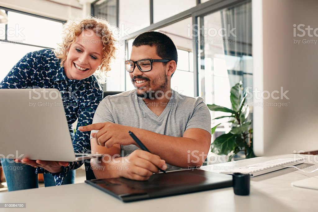 Creative people coworking on a new project in office stock photo