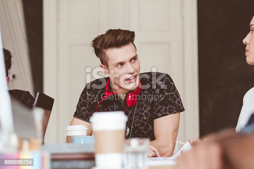 918746260istockphoto Creative people discussing in meeting 666999734