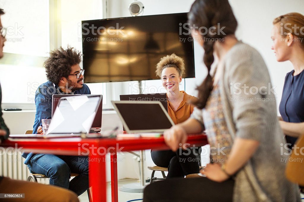 Creative people meeting in conference room stock photo