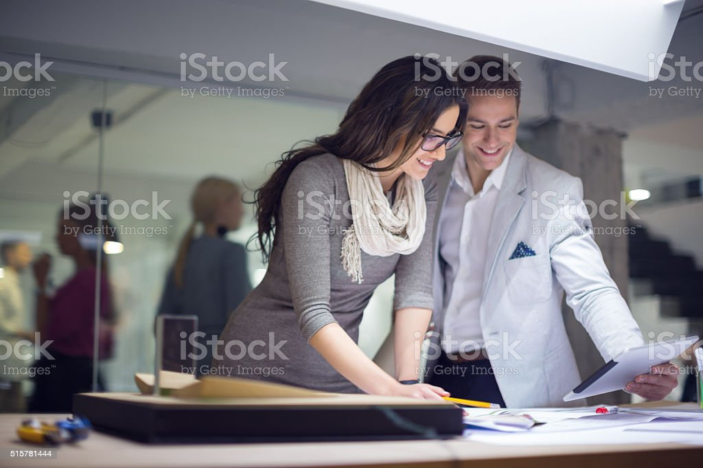 Creative people using digital tablet in studio stock photo