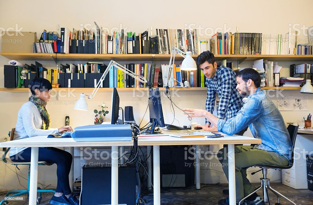 Creative people working together at startup stock photo