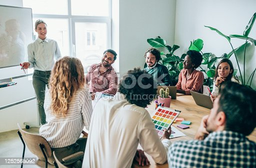 842214506 istock photo Creative person presenting her coworkers new ideas on a meeting. 1252568092
