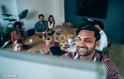 842214506 istock photo Creative person presenting his coworkers new ideas on a meeting. 1212391092