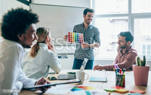 842214506 istock photo Creative person presenting his coworkers new ideas on a meeting. 1212391102