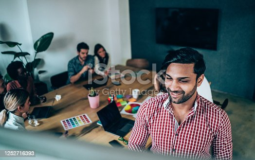 842214506 istock photo Creative person presenting his coworkers new ideas on a meeting. 1252716393