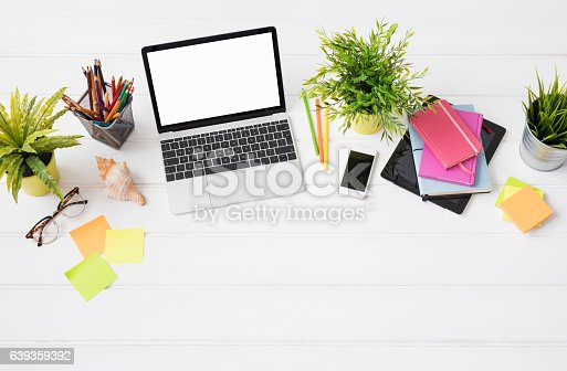 istock Creative person's desk from above in marketing agency 639359392