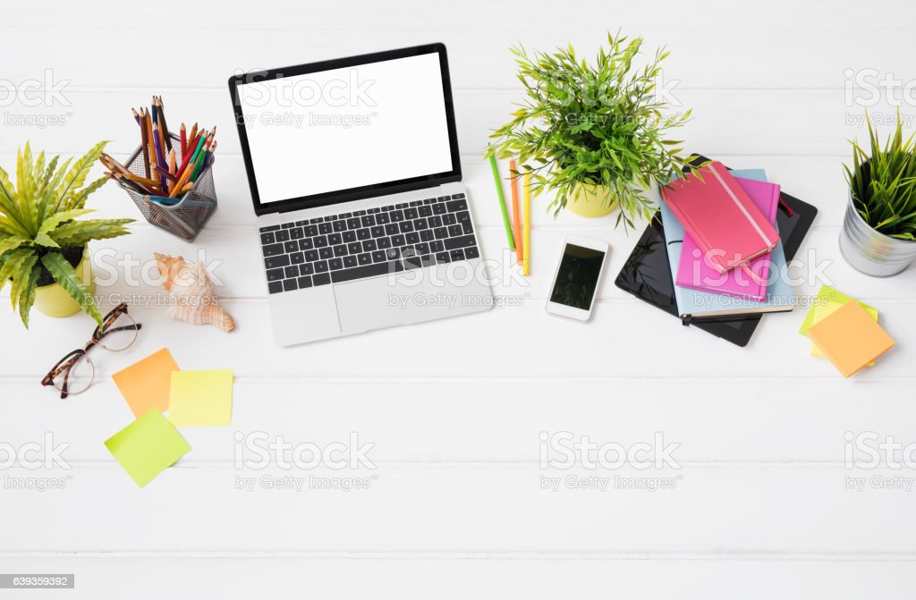 Creative person's desk from above in marketing agency stock photo