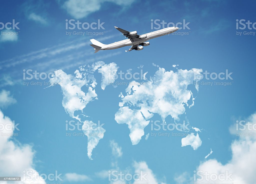 Creative photo of a jet flying over the map of the world stock photo