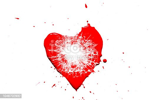 istock Creative photo of a red human heart symbol, broken into small pieces of glass isolated on a white background. Allegory of unhappy love is a broken heart. 1046702932
