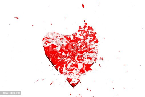 istock Creative photo of a red human heart symbol, broken into small pieces of glass isolated on a white background. Allegory of unhappy love is a broken heart. 1046703030