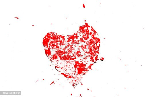 istock Creative photo of a red human heart symbol, broken into small pieces of glass isolated on a white background. Allegory of unhappy love is a broken heart. 1046703038