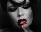istock creative portrait of woman wearing lipstick, sensual, playful, fashion 520583050