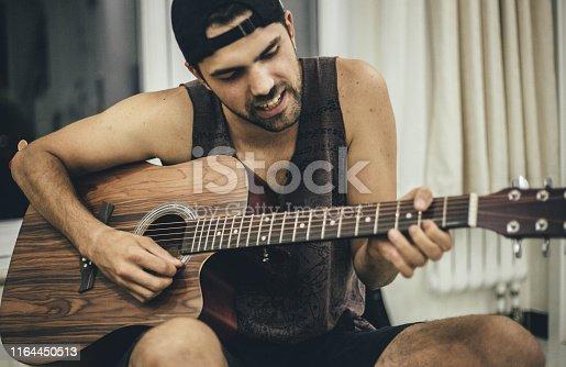 istock Creative positive nice man and guitar 1164450513