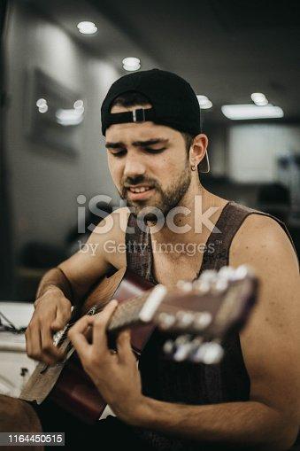 istock Creative positive nice man and guitar 1164450515