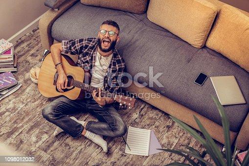 istock Creative positive nice man rehearsing a song 1098012032