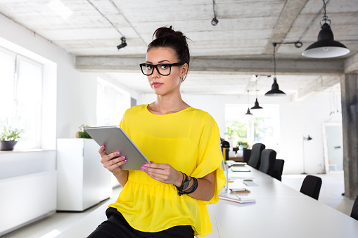 Creative Professional With Digital Tablet In Modern Office Stock Photo - Download Image Now