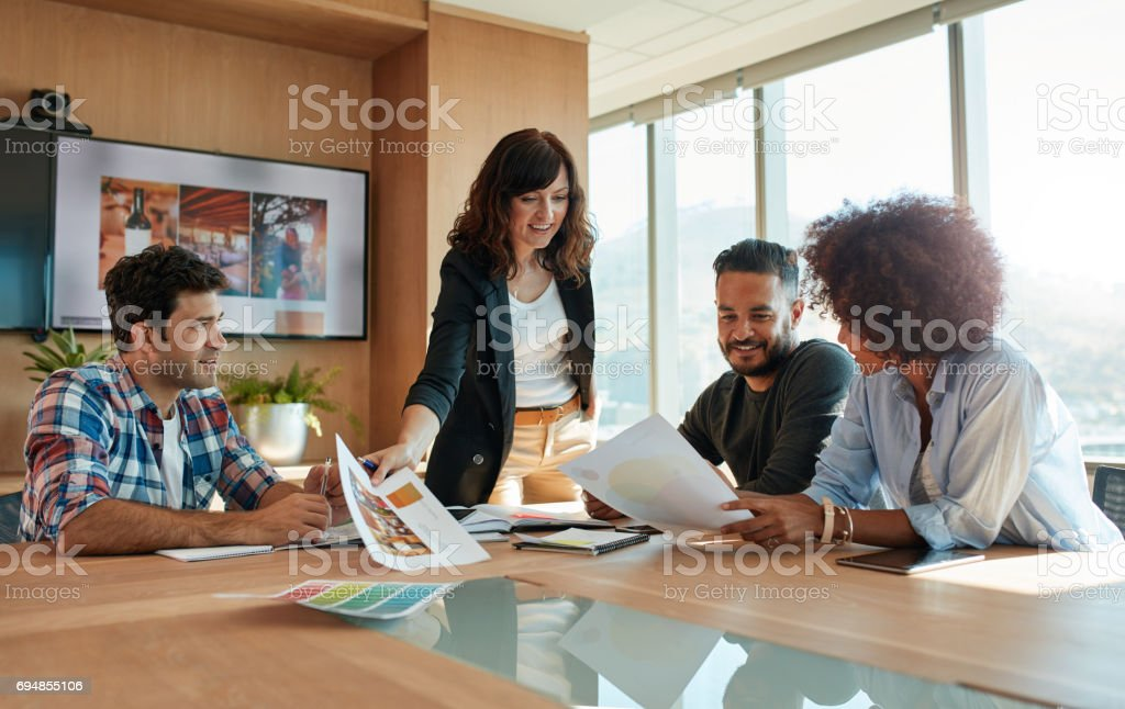 Creative professionals discussing new project in meeting stock photo