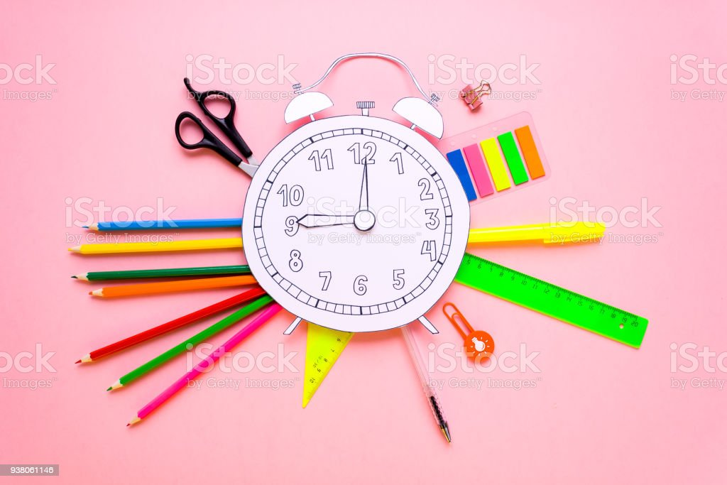 Creative school alarm made of paper with school stationery. Close up. stock photo