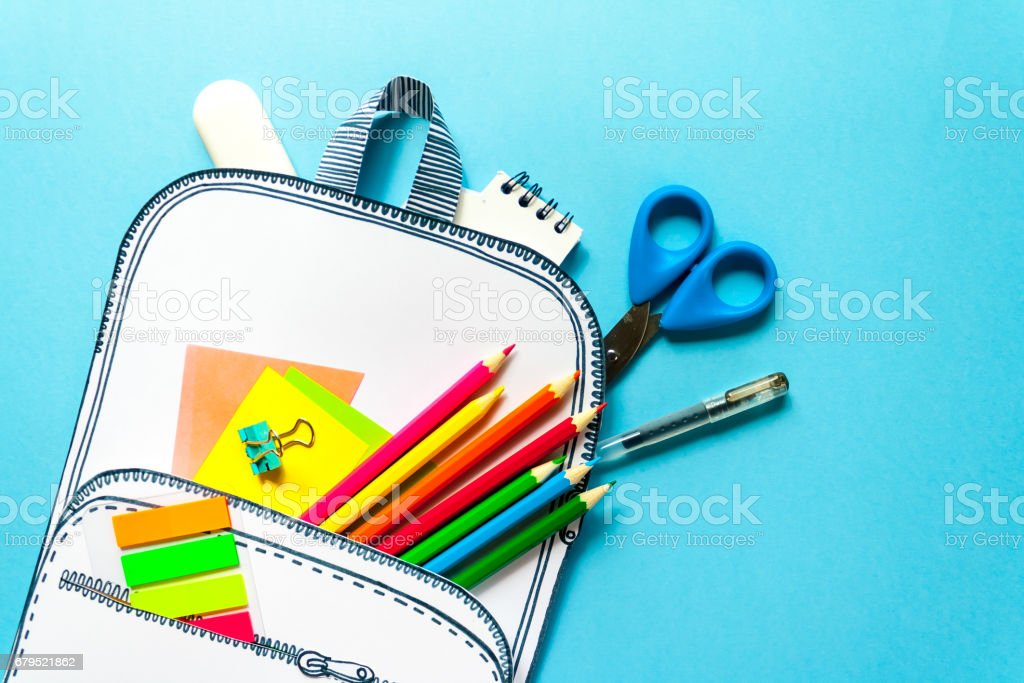 Creative school bag made of paper with school stationery. Close up. royalty-free stock photo