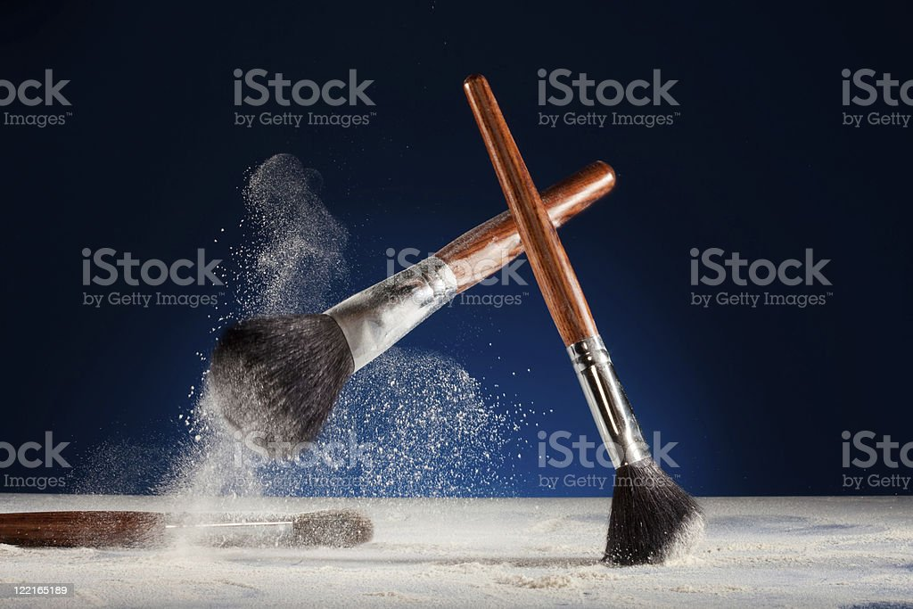Creative shoot of makeup brushes stock photo