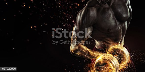 istock Creative Sport. Closeup portrait of professional bodybuilder with fire 657020526