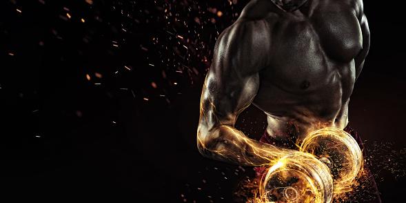 istock Creative Sport. Closeup portrait of professional bodybuilder with fire 657020526