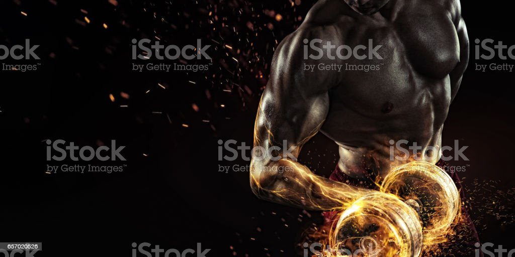 Creative Sport. Closeup portrait of professional bodybuilder with fire stock photo