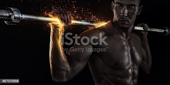 istock Creative Sport. Closeup portrait of professional bodybuilder with fire 657020558
