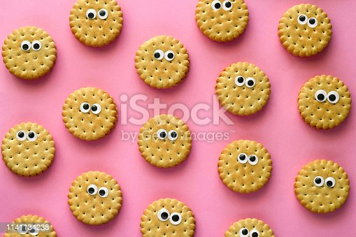 istock creative still life flat lay cookie  rows pattern on vibrant pink background 1141134238