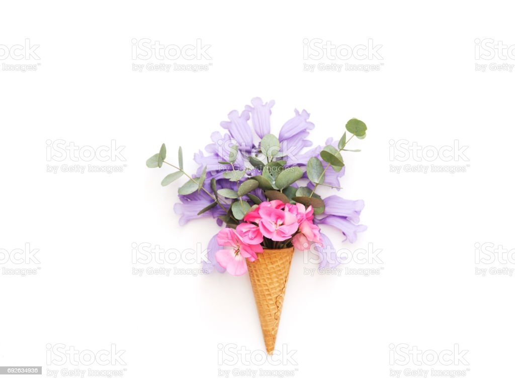 Creative still life . ice cream waffle cone with flowers . Flat lay,...