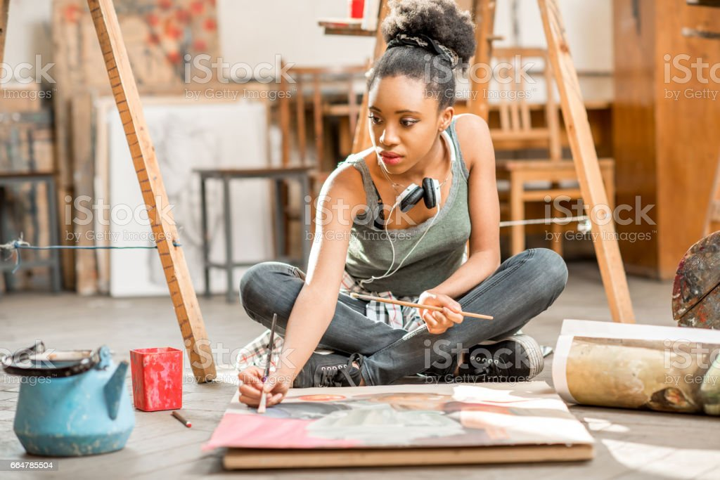 Creative student painting at the university stock photo