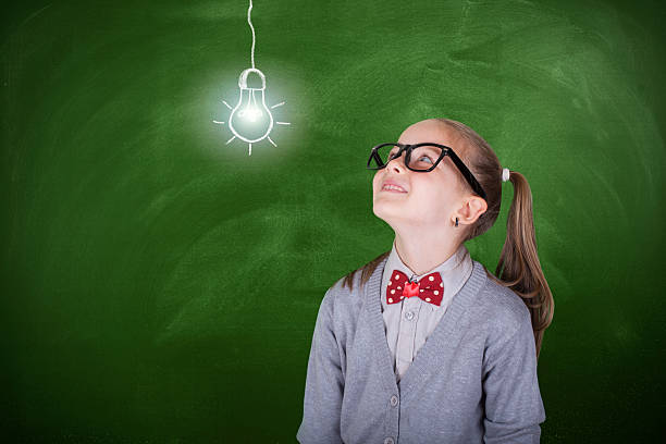 Creative student with lightbulb over head lightbulb, blackboard, child, school, student nerd hairstyles for girls stock pictures, royalty-free photos & images