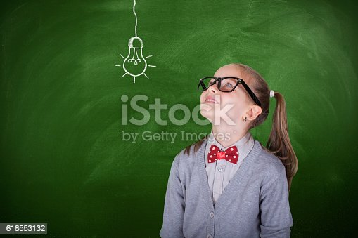 480585411 istock photo Creative student with lightbulb over head 618553132
