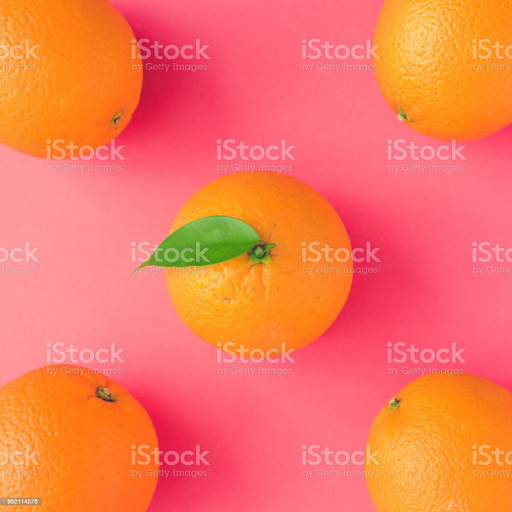 Creative summer pattern made of oranges on vivid pink background. Fruit minimal concept. stock photo