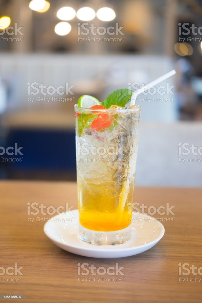 Creative sweet exotic non-alcoholic party cocktails in restaurant. Glasses with beverages on bar table, refreshing drinks with straws. stock photo