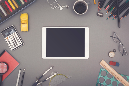 Top view creative Tablet PC mockup or hero header with copy space and creative craft items around