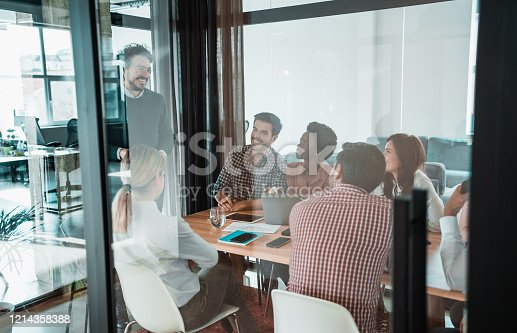 842214506 istock photo Creative team discussing plans during meeting. 1214358388