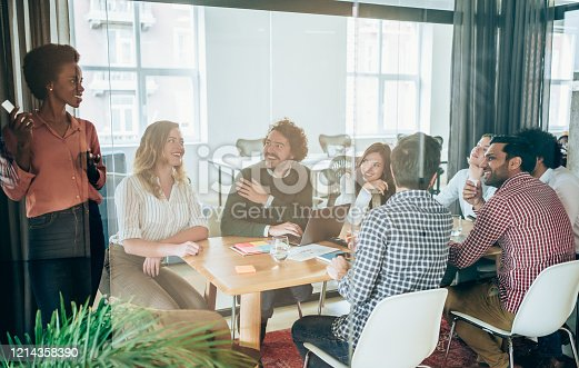 842214506 istock photo Creative team discussing plans during meeting. 1214358390