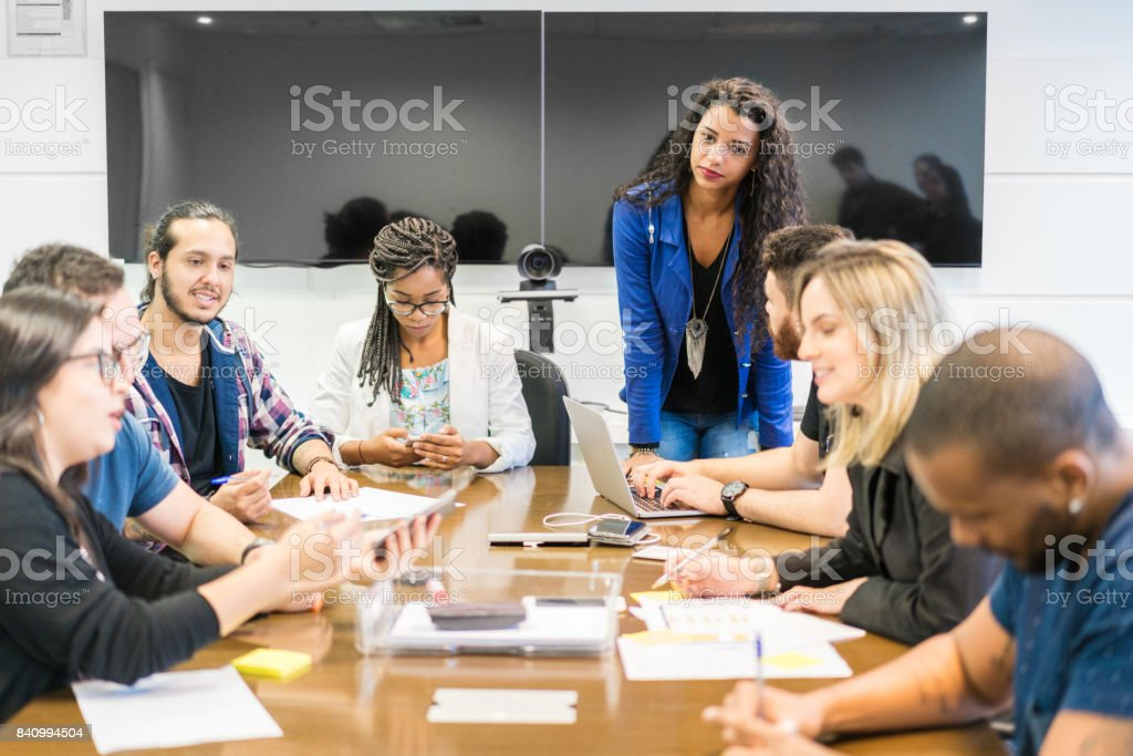 creative Team discussing with colleagues in board room at office stock photo