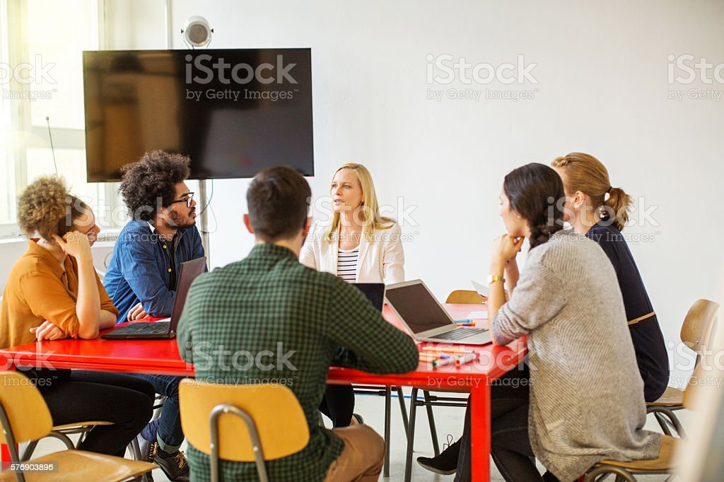 Creative team of professional having a meeting stock photo