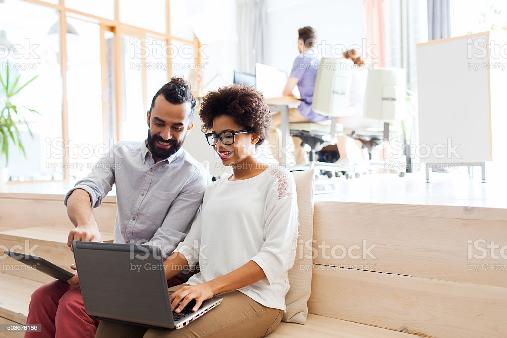 creative team with laptop and tablet pc at office stock photo