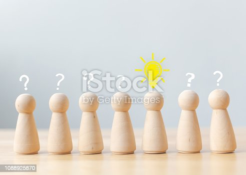 istock Creative thinking different new idea concept. Human wood with light bulb, question mark icon. Copy space for your text 1088925870
