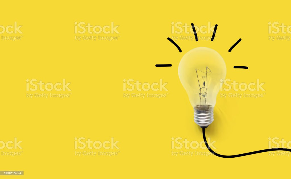 Creative thinking ideas brain innovation concept. Light bulb on yellow background royalty-free stock photo